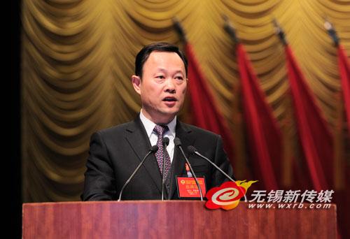 政协:周敏炜在开幕式上作报告